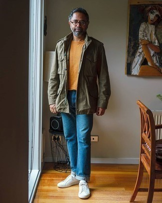 Blue Jeans Outfits For Men: This casual combination of an olive military jacket and blue jeans is very easy to pull together in no time, helping you look stylish and prepared for anything without spending too much time combing through your wardrobe. Finishing off with white canvas low top sneakers is a guaranteed way to inject a more laid-back feel into your outfit.