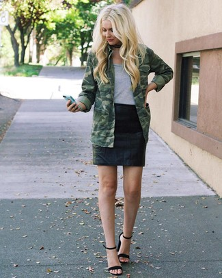 How to wear: olive camouflage military jacket, grey crew-neck t-shirt, black leather mini skirt, black suede heeled sandals