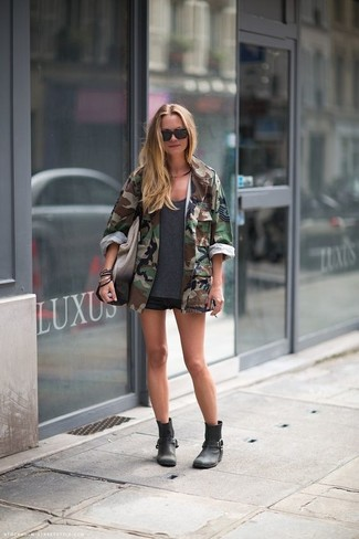 How to wear: dark green camouflage military jacket, charcoal crew-neck t-shirt, black denim shorts, black leather ankle boots
