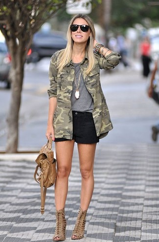 How to wear: olive camouflage military jacket, grey crew-neck t-shirt, black denim shorts, tan cutout leather ankle boots