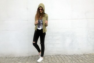 How to wear: olive military jacket, white and black print crew-neck t-shirt, black ripped skinny jeans, white low top sneakers
