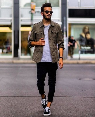 How to wear: olive military jacket, grey crew-neck t-shirt, black ripped skinny jeans, black canvas low top sneakers