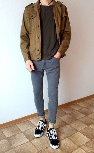 How to Wear Grey Skinny Jeans For Men: If you're on the lookout for a casual but also stylish look, make a brown military jacket and grey skinny jeans your outfit choice. Complement your outfit with black and white canvas low top sneakers and the whole getup will come together perfectly.