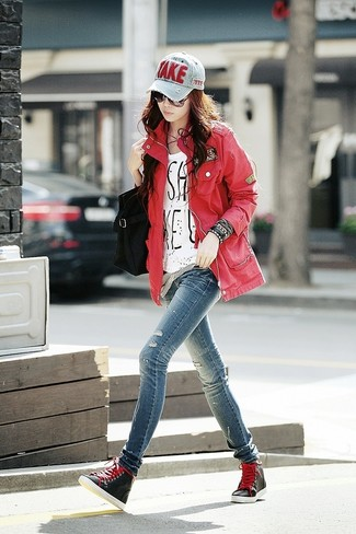 How to wear: red military jacket, white and black print crew-neck t-shirt, blue ripped skinny jeans, black high top sneakers