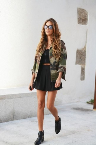 How to wear: olive camouflage military jacket, black cropped top, black skater skirt, black leather ankle boots