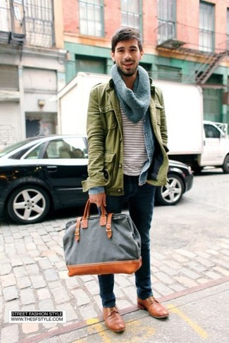 How to wear: olive military jacket, light blue denim shirt, white and red horizontal striped crew-neck t-shirt, navy jeans