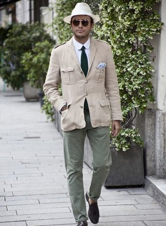 How to Wear Dark Brown Suede Tassel Loafers: A beige military jacket and olive chinos are veritable menswear must-haves if you're planning a casual closet that holds to the highest style standards. To add a little depth to your getup, add a pair of dark brown suede tassel loafers to the mix.