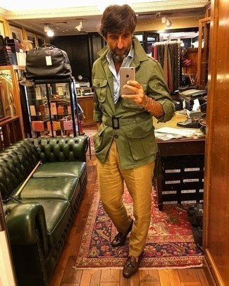 How to Wear an Olive Military Jacket For Men: This is definitive proof that an olive military jacket and mustard dress pants are awesome when married together in a refined ensemble for today's gent. If you're not sure how to finish, a pair of brown leather tassel loafers is a nice pick.