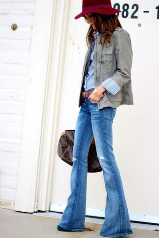 How to wear: grey military jacket, blue vertical striped dress shirt, blue flare jeans, navy suede pumps