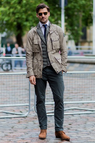 How to wear: beige military jacket, olive quilted gilet, white dress shirt, charcoal chinos