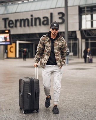 Military Jacket Outfits For Men: Reach for a military jacket and grey sweatpants for a casual and stylish outfit. A pair of black athletic shoes can effortlessly play down an all-too-classic ensemble.
