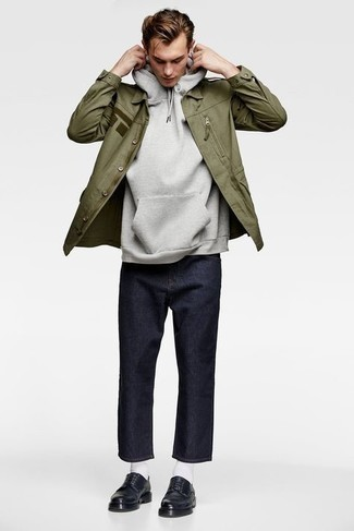 Sweater Outfits For Men: This relaxed combo of a sweater and navy jeans is super easy to throw together without a second thought, helping you look amazing and prepared for anything without spending too much time digging through your closet. Bring a hint of polish to your ensemble by sporting black leather derby shoes.