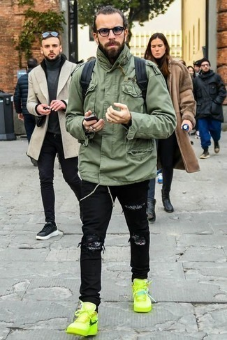 How to Wear Jeans For Men: This city casual combo of an olive military jacket and jeans is extremely easy to pull together without a second thought, helping you look awesome and ready for anything without spending a ton of time going through your closet. Introduce a pair of green-yellow leather high top sneakers to your look to easily boost the street cred of this look.