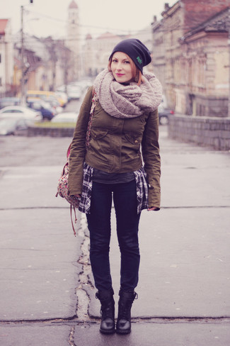 How to wear: brown military jacket, navy jeans, black leather lace-up flat boots, beige floral canvas backpack