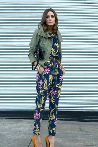 Women's Outfits 2020: If you're a fan of comfort dressing, why not take this combination of an olive military jacket and a navy floral jumpsuit for a spin? To bring a little fanciness to this outfit, add a pair of mustard suede pumps to the mix.