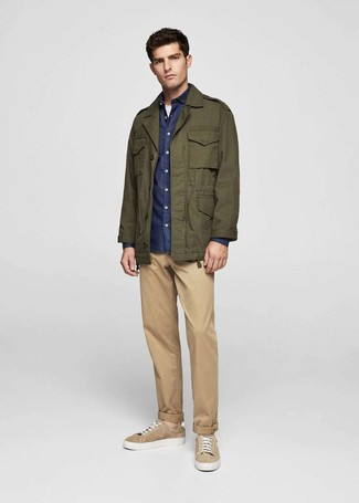 How to wear: olive military jacket, navy chambray long sleeve shirt, white crew-neck t-shirt, khaki chinos
