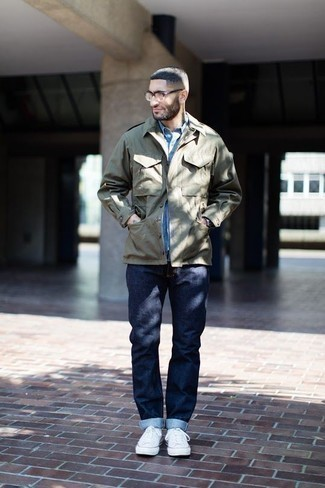 How to Wear an Olive Military Jacket For Men: Why not wear an olive military jacket with navy jeans? These two pieces are very functional and will look awesome worn together. A pair of white canvas low top sneakers will bring a more casual aesthetic to the outfit.