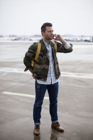 How To Wear Jeans With Boots For Men: An olive camouflage military jacket and jeans are essential in any gentleman's versatile casual wardrobe. Boots will inject an added touch of style into an otherwise everyday getup.