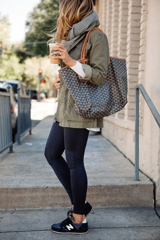 Black Leggings Outfits: This casual combination of an olive military jacket and black leggings is extremely easy to pull together in next to no time, helping you look chic and prepared for anything without spending too much time combing through your wardrobe. Feeling inventive? Switch things up by rocking a pair of black athletic shoes.
