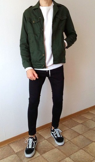 How to Wear Black and White Canvas Low Top Sneakers For Men: Try teaming a dark green military jacket with black skinny jeans for a stylish, off-duty ensemble. Introduce black and white canvas low top sneakers to the mix and ta-da: this ensemble is complete.