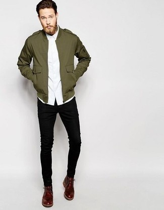 Burgundy Leather Desert Boots Outfits: If the situation permits a casual getup, you can easily rock an olive military jacket and black skinny jeans. And if you want to effortlessly lift up your getup with a pair of shoes, complement this getup with a pair of burgundy leather desert boots.