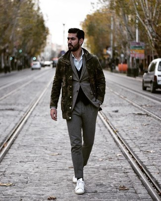 White and Red Leather Low Top Sneakers Dressy Outfits For Men: Teaming an olive camouflage military jacket and a grey wool suit is a guaranteed way to infuse your closet with some rugged refinement. Why not choose a pair of white and red leather low top sneakers for a more relaxed touch?