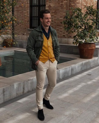 Black Suede Chelsea Boots Outfits For Men: A dark green military jacket and beige chinos are a good ensemble that will take you throughout the day. Black suede chelsea boots will instantly polish off even your most comfortable clothes.