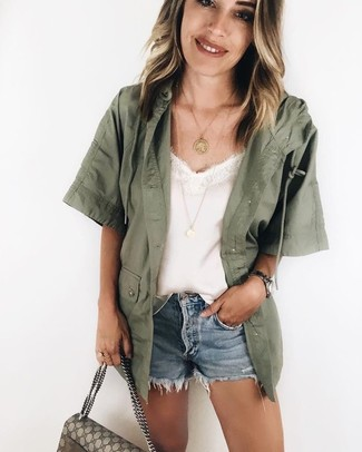 How to wear: olive military jacket, white silk tank, light blue denim shorts, beige print canvas satchel bag