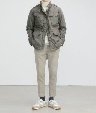Men's Looks & Outfits: What To Wear In Warm Weather: This relaxed casual pairing of a grey military jacket and beige chinos is a lifesaver when you need to look great but have zero time to dress up. To add a laid-back touch to your look, complement your outfit with beige suede low top sneakers.