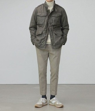 Olive Military Jacket Outfits For Men: Display your chops in men's fashion by pairing an olive military jacket and beige chinos for an off-duty getup. And if you wish to instantly dress down your outfit with a pair of shoes, why not add a pair of beige athletic shoes to this look?