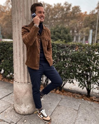 Military Jacket Outfits For Men: This off-duty pairing of a military jacket and navy vertical striped chinos is very easy to throw together without a second thought, helping you look amazing and prepared for anything without spending too much time combing through your closet. Rev up the style factor of this look by sporting a pair of tan athletic shoes.