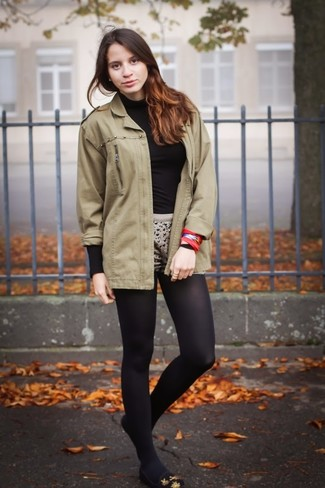 How to Wear Black Tights: An olive military jacket and black tights are a good combo that will carry you throughout the day and into the night. And if you need to effortlesslly rev up this getup with a pair of shoes, introduce black suede ballerina shoes to this ensemble.