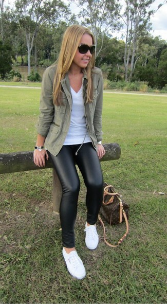 How to wear: olive military jacket, white v-neck t-shirt, black leather leggings, white low top sneakers