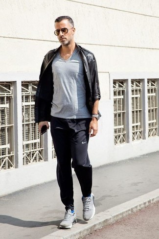 How to Wear a Grey V-neck T-shirt For Men: This combo of a grey v-neck t-shirt and black sweatpants is dapper and yet it looks casual and apt for anything. On the shoe front, this look is rounded off well with grey athletic shoes.