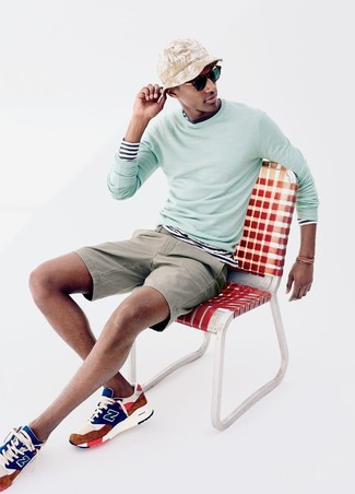 How to wear: mint crew-neck sweater, white and navy horizontal striped long sleeve t-shirt, beige shorts, multi colored athletic shoes