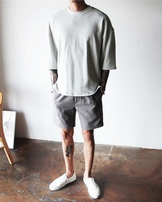 How to Wear Grey Shorts For Men: A mint crew-neck t-shirt and grey shorts are the perfect foundation for a ton of outfits. Feeling transgressive? Spruce up your getup by wearing white canvas slip-on sneakers.