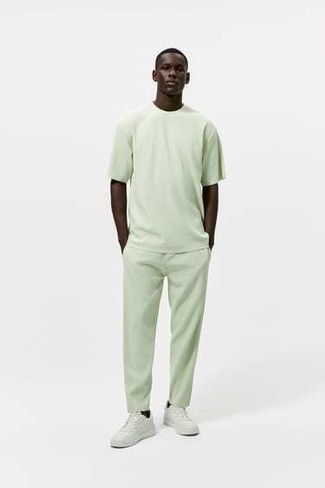 Mint Chinos Outfits: Pair a mint crew-neck t-shirt with mint chinos to achieve a daily outfit that's full of charm and personality. The whole look comes together wonderfully when you go for a pair of white leather low top sneakers.