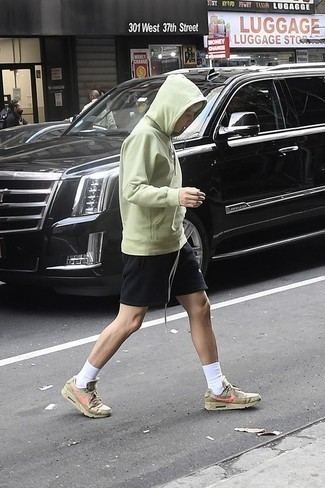 How to Wear a Mint Hoodie For Men: A mint hoodie and black sports shorts are totally worth adding to your list of essential casual styles. When not sure as to the footwear, go with olive athletic shoes.