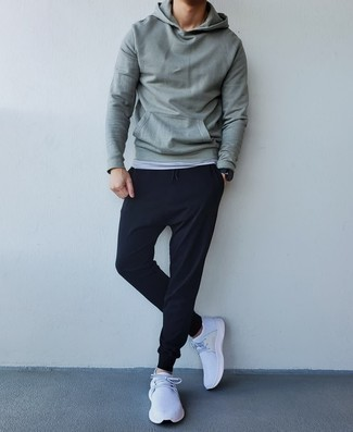 White Athletic Shoes Outfits For Men: A mint hoodie and black sweatpants are essential in any modern man's functional casual wardrobe. If you don't know how to finish, a pair of white athletic shoes is a fail-safe option.