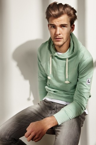 How to Wear a Mint Hoodie For Men: Super stylish and functional, this off-duty pairing of a mint hoodie and grey jeans provides with amazing styling possibilities.