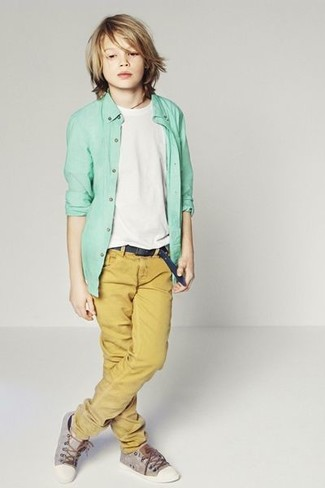 How to Wear Charcoal Sneakers In Summer For Boys: Suggest that your munchkin pair a mint long sleeve shirt with mustard trousers to help him look like a true little gent. This look is complemented nicely with charcoal sneakers.