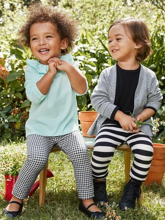 A mint long sleeve t-shirt and black and white check leggings are a great outfit for your little angel to go out exploring. Finish off this look with navy blue ballet flats.