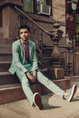 Green Suit with Sneakers Outfits: A green suit and a pink crew-neck t-shirt are the kind of a no-brainer look that you so desperately need when you have no time to spare. Complement your outfit with a pair of sneakers to add a sense of stylish effortlessness to your look.