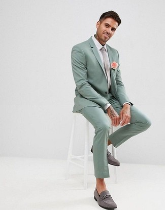 How to Wear a Mint Suit: Marrying a mint suit and a white dress shirt is a surefire way to inject your wardrobe with some masculine elegance. Grey suede loafers will bring a more relaxed finish to an otherwise all-too-safe look.