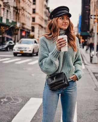 Go for a pastel green wool turtleneck and a newsboy cap to achieve new levels in outfit coordination. This getup is super comfortable and will help you out in weird transition weather.