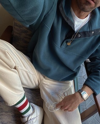 Mock-Neck Sweater Outfits: For an effortlessly smart menswear style, reach for a mock-neck sweater and beige chinos — these two items play beautifully together. You could perhaps get a little creative when it comes to footwear and complete this look with white leather low top sneakers.