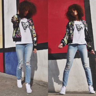 This combo of a multi colored graphic bomber and baby blue ripped skinny jeans will attract attention for all the right reasons. Grab a pair of white high top sneakers for a more relaxed feel.