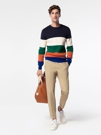 How to Wear a Multi colored Crew-neck Sweater For Men: A multi colored crew-neck sweater and khaki chinos worn together are the perfect ensemble for guys who appreciate casual ensembles. When this getup appears all-too-fancy, play it down by slipping into a pair of white canvas low top sneakers.