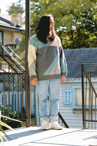 Light Blue Jeans Outfits For Men: A multi colored crew-neck sweater and light blue jeans are among those super versatile menswear items that can completely change your wardrobe. A pair of white canvas low top sneakers is the glue that brings this ensemble together.