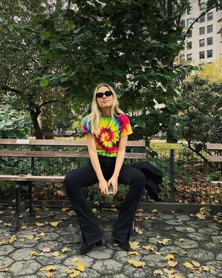 Black Flare Jeans Outfits: A multi colored tie-dye crew-neck t-shirt and black flare jeans paired together are such a dreamy getup for those dressers who love ultra-cool outfits. For a more sophisticated take, complete your ensemble with a pair of black suede ankle boots.